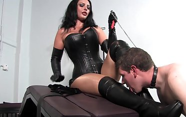 Dominant woman pleases herself with young slave learn of