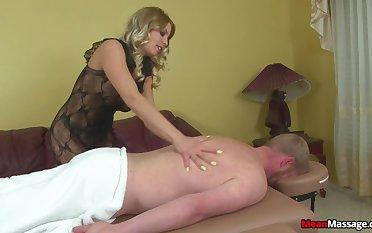 Stern blonde wraps rope around a cock during Femdom handjob