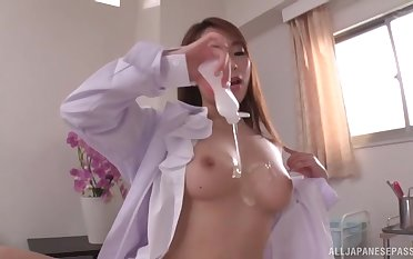 Sexy Asian nurse takes off her clothes to ride a lucky covering