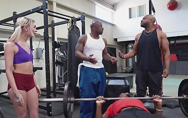 Two black stallions ass bonk a petite blonde down at the gym