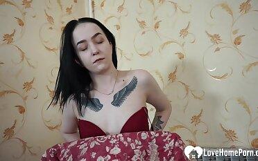 Cute tattooed beauty pleasuring herself in the chair