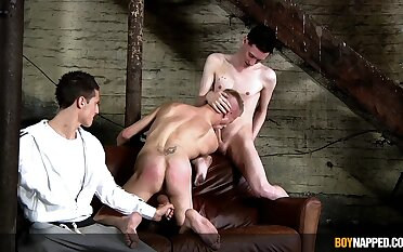 Bald twink plays submissive in the feature of two merciless gay cocks