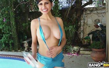 Horny pornstar Mia Khalifa drops her clothing and sucks a dildo