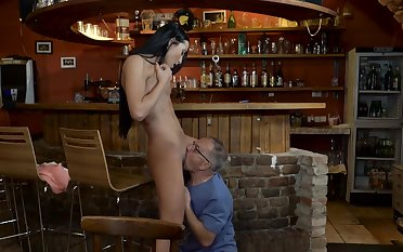 Girl at the bar fucked by senior guy on a table