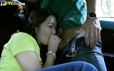 The Asian girl is fed with long ebony gun stick