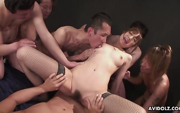 Japanese cutie in fishnets rides a dick for an turnout